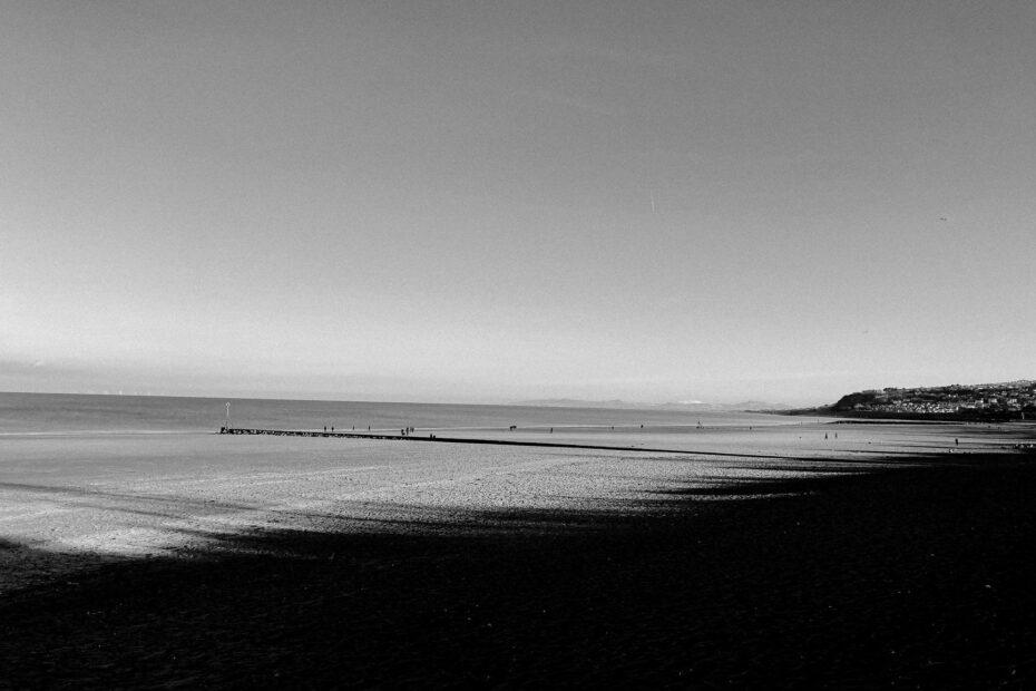 sea waves rolling on sandy shore in daylight